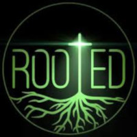 This is a picture of the word rooted with a cross used for the t in the word